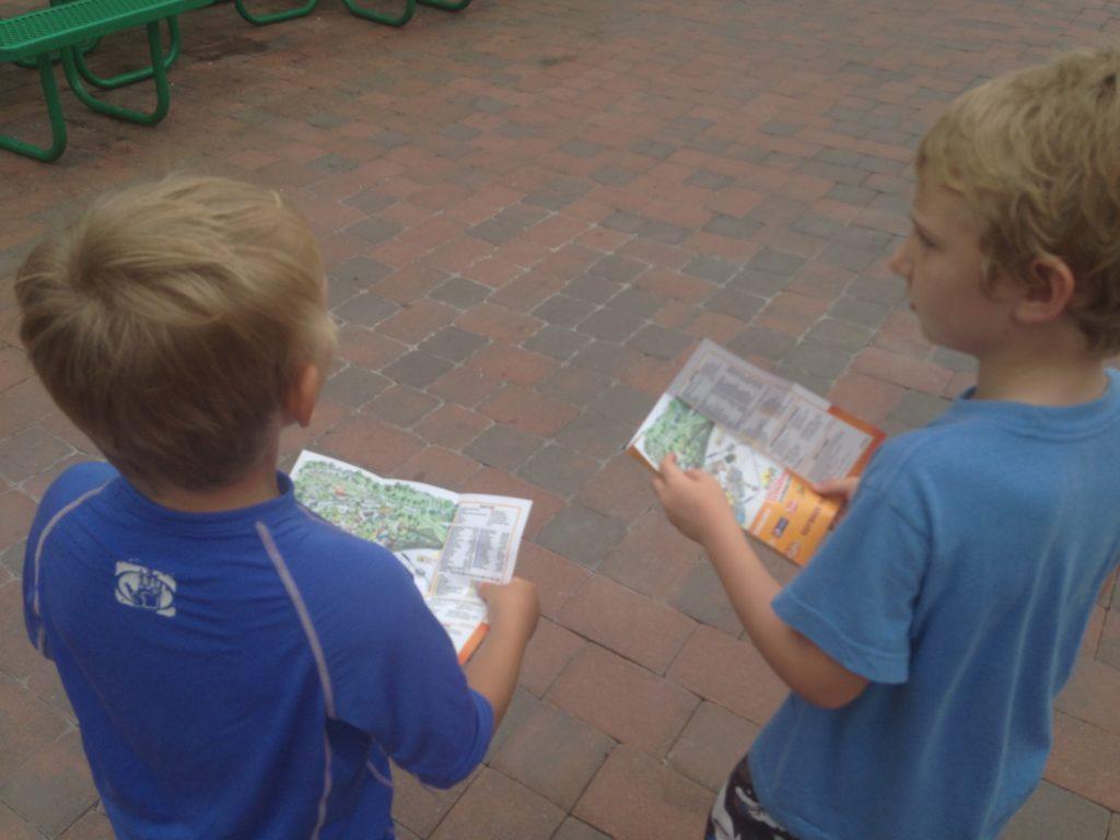 boys following dutch wonderland maps