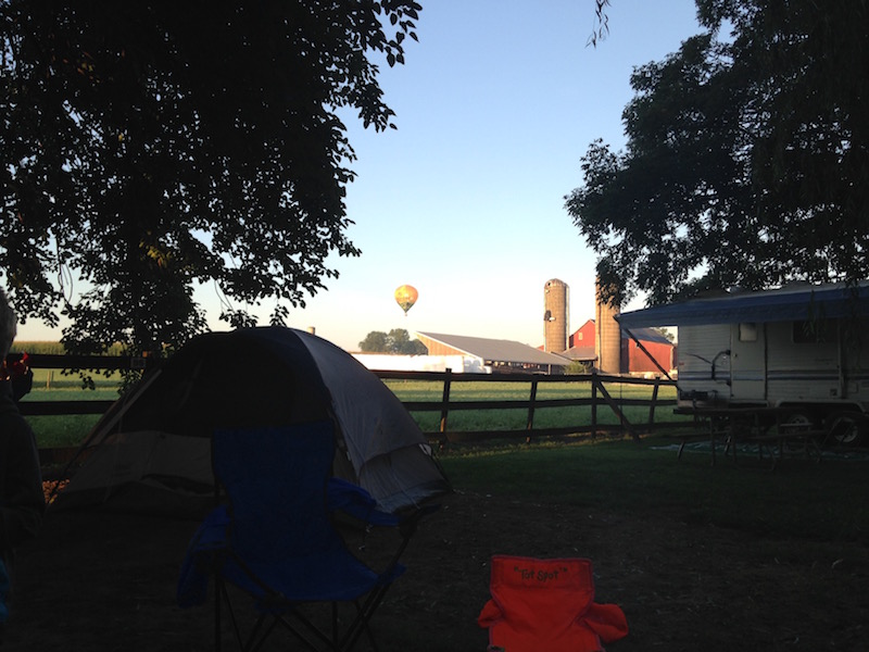 first camping trip with kids success hot air balloon over campsite mill bridge