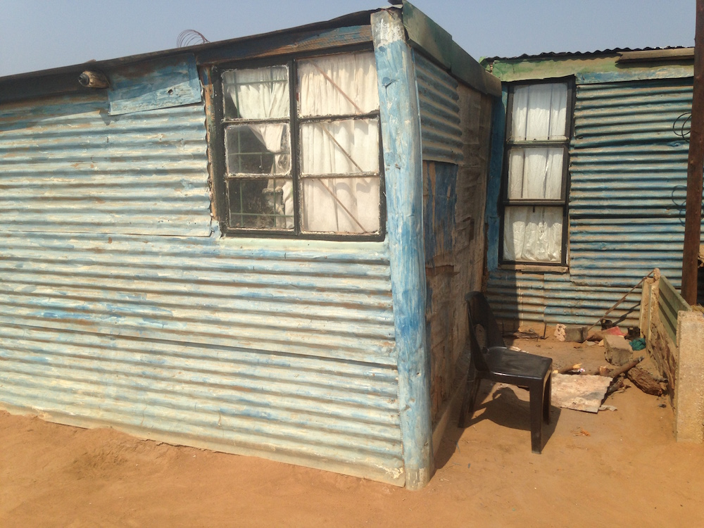 south africa tin hut living conditions